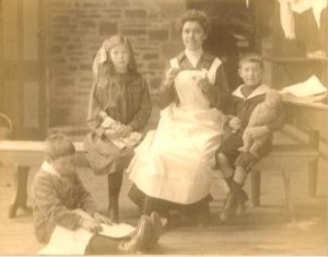 The picture shows Celestine Michels and children that are probably her own. She lived in the 'Belgian House' at Ridgebourne. (Photograph by kind permission of W. L. Banks and the Hergest Trust Archive)